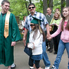 Record-Eagle/Douglas Tesner<br /> Xene Medina wears Ryan Gauthier's mortar board as he heads in for his graduation from Traverse City West Senior High School.
