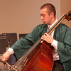 Record-Eagle/Douglas Tesner<br /> Shawn Lowe warms up with his bass before the start of Traverse City West Senior High School's Commencement Ceremony. This was the last time Lowe performed with the orchestra.