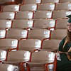 Record-Eagle/Douglas Tesner<br /> Michelle Harrington sits in solitude before the Traverse City West Senior High School commencement ceremony.  This is a bittersweet experience, she said.