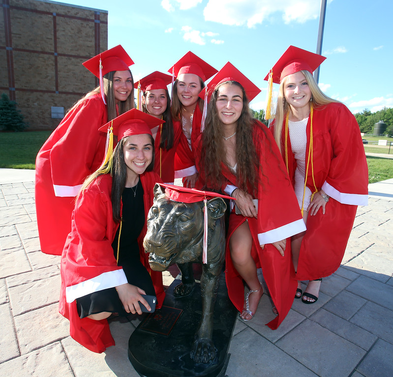 . Clockwise from front left, Sara Anselmo, Angie DiLello, Melissa Hauman, Amanda Pare, Taylor Hapenny and Lindsay Riley, pose with the tiger statue before Tyngsboro High graduation. (SUN/Julia Malakie)