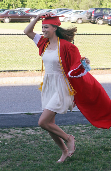 Tyngsboro High graduation. Emma Strong runs to join friends for a photo. (SUN/Julia Malakie)