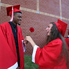 Tyngsboro High graduation. Taylor Hapenny, right, shows Elcharis Kamuanga, her rose. (SUN/Julia Malakie)