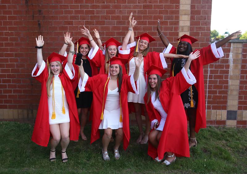 Posing for group photo before Tyngsboro High graduation, from left, front: Lindsay Riley, Melissa Hauman, and Angie DeLello. Rear: Sara Anselmo, Amanda Pare, Emma Strong and Hawa Bangura. (SUN/Julia Malakie)