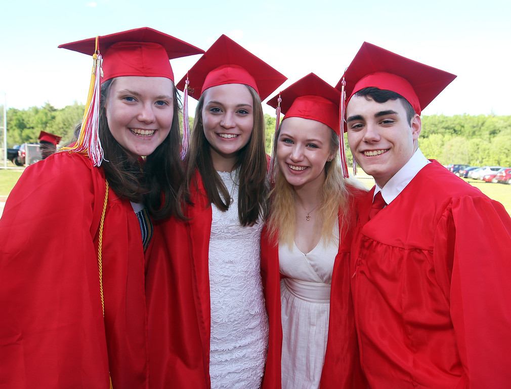 . From left, Terryn Fraser-Mines, Lizzie Storry, FaithMary Harding and Joseph Manzo, before Tyngsboro High graduation. (SUN/Julia Malakie)