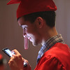 Colby Foster watches videos before Tyngsboro High graduation. (SUN/Julia Malakie)