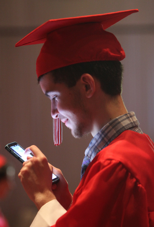 . Colby Foster watches videos before Tyngsboro High graduation. (SUN/Julia Malakie)