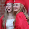 Tyngsboro High graduation. Hayley Altenweg, left, and Kellie Martin, pose for photo before graduation. (SUN/Julia Malakie)