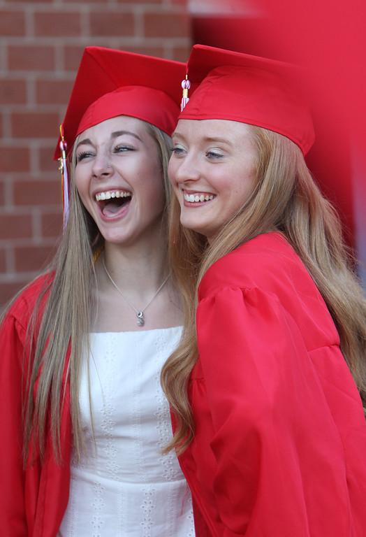 . Tyngsboro High graduation. Hayley Altenweg, left, and Kellie Martin, pose for photo before graduation. (SUN/Julia Malakie)