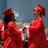Suzanna Samuel, left, and Susanne Kruszkowski dance in the auditorium before Tyngsboro High graduation. (SUN/Julia Malakie)