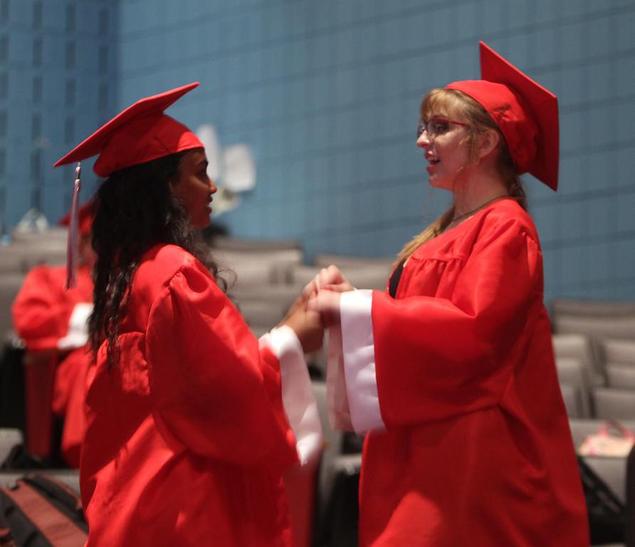 . Suzanna Samuel, left, and Susanne Kruszkowski dance in the auditorium before Tyngsboro High graduation. (SUN/Julia Malakie)