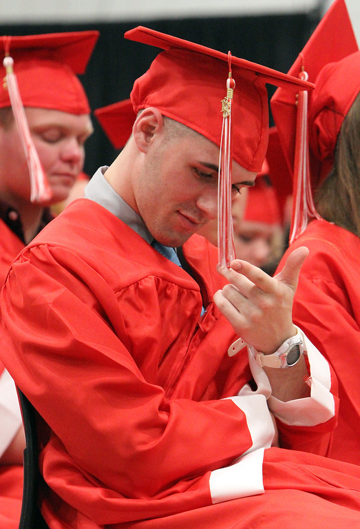 . Tyngsboro High graduation. Tim Briere plays with his tassel. (SUN/Julia Malakie)