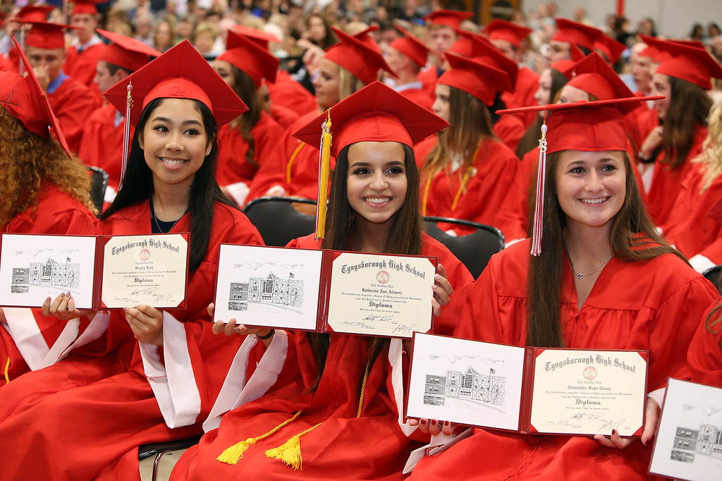 . Tyngsboro High graduation. From left, Sophia Buth, Katherine Alvarez and Alexandra Casey. (SUN/Julia Malakie)