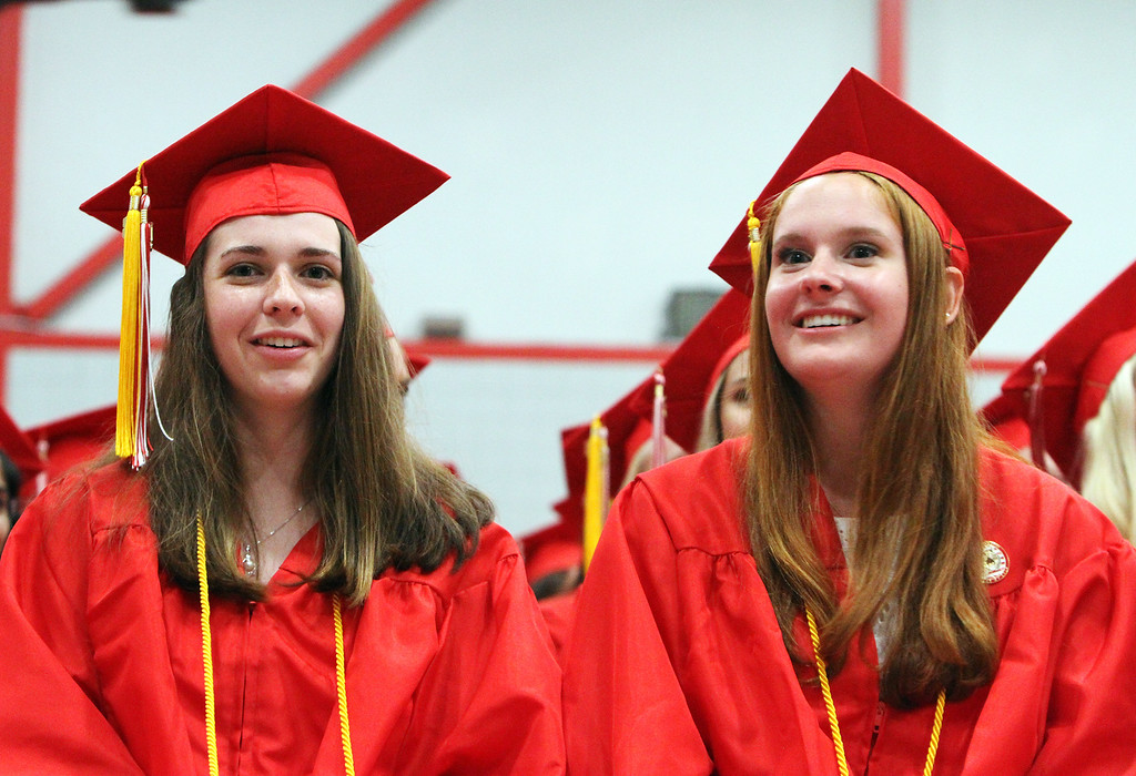 . Tyngsboro High graduation. Co-valedictorians Sara Moran, left, and Quinn Kilmartin. Principal Jeffrey Ogden said their GPAs were tied out to eight decimal places. (SUN/Julia Malakie)