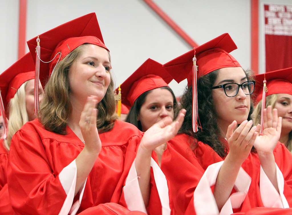 . Tyngsboro High graduation. Hanna McDonald, left, and Megan Smyth. (SUN/Julia Malakie)