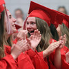 Tyngsboro High School graduation, at the high school. Angelica Heyl, center, reacts during valedictory address. (SUN/Julia Malakie)