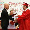 Tyngsboro High School graduation, at the high school. Principal Jeffrey Ogden presents Clifford Campbell II his diploma. (SUN/Julia Malakie)
