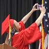 Tyngsboro High School graduation, at the high school. Salutatorian/Vice President Catherine Riley starts off with a class selfie. (SUN/Julia Malakie)