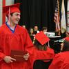 Tyngsboro High School graduation, at the high school. John Rowbotham returns to his seat after receiving diploma. (SUN/Julia Malakie)