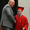 Tyngsboro High School graduation, at the high school. Superintendent of Schools Michael Flanagan presents the diploma to his son Connor Flanagan. (SUN/Julia Malakie)