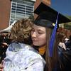 UMass Lowell Commencement. Graduate Julie Pieslak of Lowell hugs her aunt Gail Novak of Kingston, N.H. (SUN/Julia Malakie)