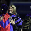 UMass Lowell Commencement. Commencement speaker, U.S. Rep. Lori Trahan, hugs chancellor Jacquie Moloney, as president Marty Meehan looks on. (SUN/Julia Malakie)