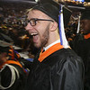 UMass Lowell Commencement. Michael Hoppe of East Bridgewater heads up to get his diploma. (SUN/Julia Malakie)