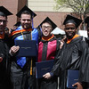 UMass Lowell Commencement. Mechanical Engineering graduates Michael Hoppe of East Bridgewater, Nicholas Deane of Jefferson, Mass., Kevin Truong of Quincy, and twin brothers Widmark and Wilmark Vilno of Whitman. (SUN/Julia Malakie)