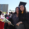 UMass Lowell Commencement. Graduate Jennifer Lee of Lowell, right, with her good friend Rupal Patel of Lexington. (SUN/Julia Malakie)