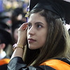 UMass Lowell Commencement. Angie Hinojosa of Lowell in line for diploma. (SUN/Julia Malakie)
