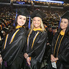 UMass Lowell Commencement. From left, Anna Drummey of Hudson, Mass., Samantha Rizzo of Everett and Shayla Monteiro of Worcester. (SUN/Julia Malakie)