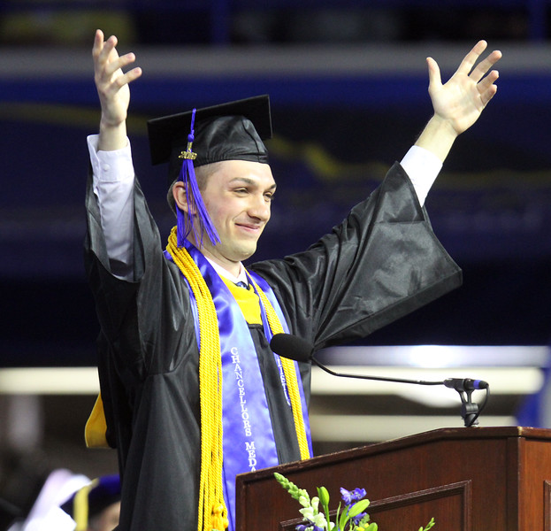 """UMass Lowell Commencement. Student speaker in the morning exercises, Richard Macdonald of Billerica, who said he came to UML wanting to become a doctor, says """"I achieved my dream. I was accepted to UMass Medical School."""" (SUN/Julia Malakie)"""