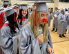 Upper Dublin High School Class of 2014 member Anna Trentini smells her carnation as the class  lines up in the gym before the start of  their Commencement Ceremony at the school on Tuesday evening June 10,2014. Photo by Mark C Psoras/The Reporter