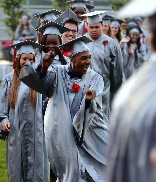 . Upper Dublin High School Class of 2014 member Joezel Newman Jr. does a dance as he is announced to recieve his diploma during their Commencement Ceremony at the school on Tuesday evening June 10,2014. Photo by Mark C Psoras/The Reporter
