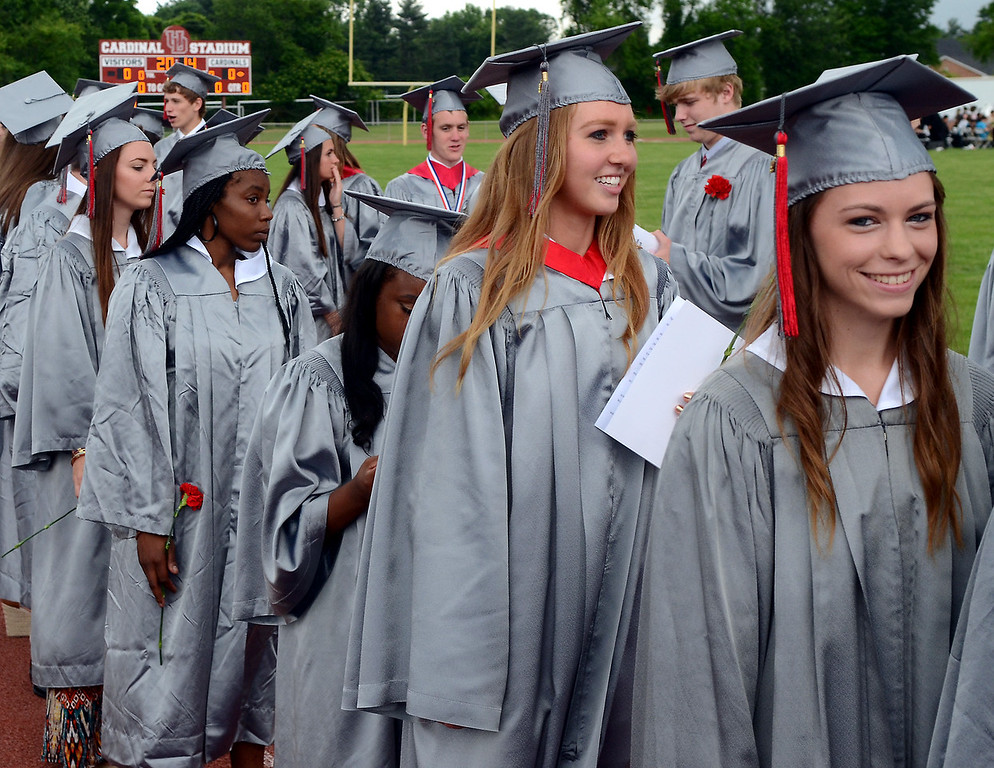 . Upper Dublin High School Class of 2014 members march into the stadium for their Commencement Ceremony at the school on Tuesday evening June 10,2014. Photo by Mark C Psoras/The Reporter
