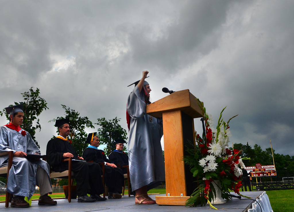 . Upper Dublin High School Class of 2014 member Jenna Mandel gives the Greeting as storm clouds gather overhead during their Commencement Ceremony at the school on Tuesday evening June 10,2014. Photo by Mark C Psoras/The Reporter