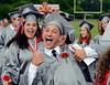 Upper Dublin High School Class of 2014 members joke around as they march into the stadium for their Commencement Ceremony at the school on Tuesday evening June 10,2014. Photo by Mark C Psoras/The Reporter