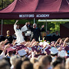 "Westford Academy seniors and staff members perform the traditional ""Ghost Coaster"" at Friday's graduation. Lowell Sun/Chris Lisinski"
