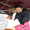Westford Academy graduation. Guidance counselor Wendy Pechacek hugs salutatorian Anthony Zhu after speaking about him. (SUN/Julia Malakie)