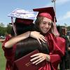 Westford Academy graduation.  Annie Benting, facing, hugs class treasurer Veronica Xu after getting her diploma. SUN/Julia Malakie