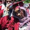 Westford Academy graduation. Zannatul Akbor hangs onto her cap in a breeze.  SUN/Julia Malakie