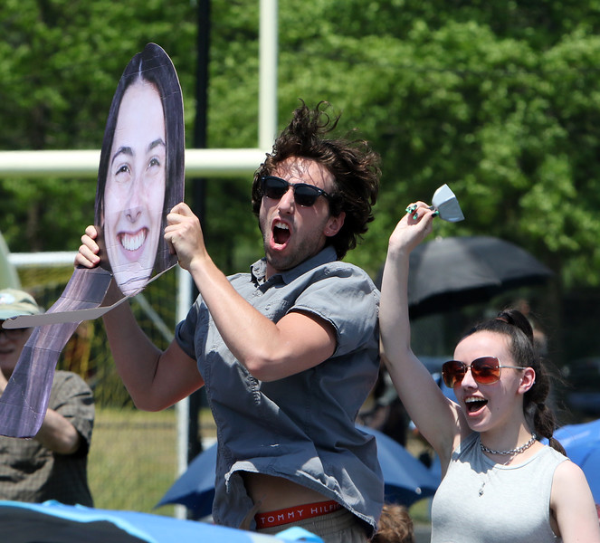 Westford Academy graduation.  Megan O'Connor (WA Class of 2018, now a student at UConn), and her boyfriend Nick Luberto, cheer for O'Connor's sister Jackie O'Connor, whose picture Luberto is holding. SUN/Julia Malakie