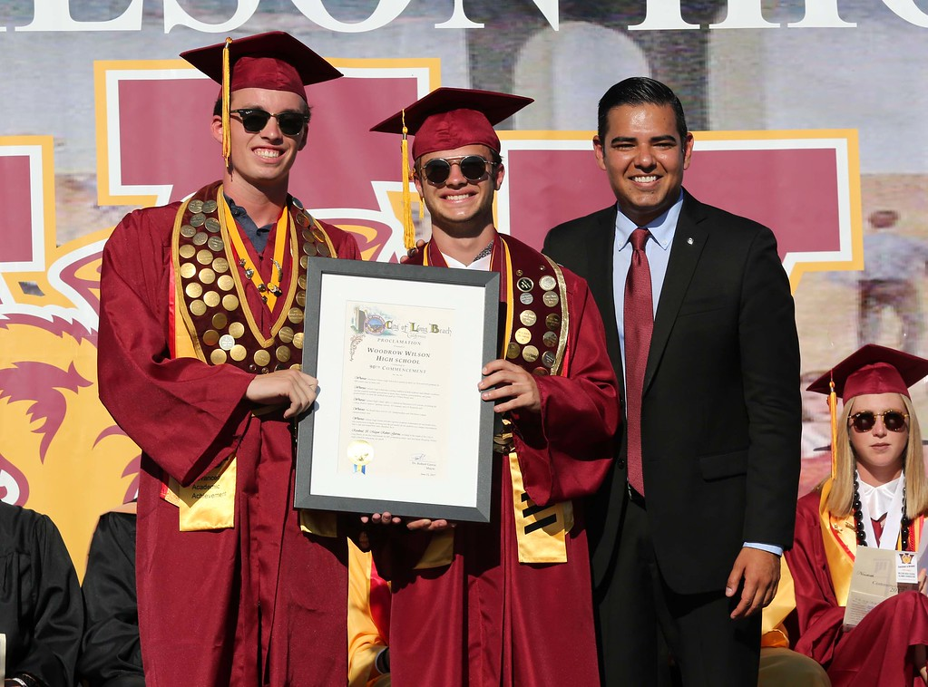 . June 15, 2017-Photo by Tracey Roman/for the Press-Telegram Kobe Jackson and Luke Zell accept a recognition of the 90th commencement ceremony from Long Beach Mayor Dr. Robert Garcia during the Wilson High School Gradution Ceremony Thursday.