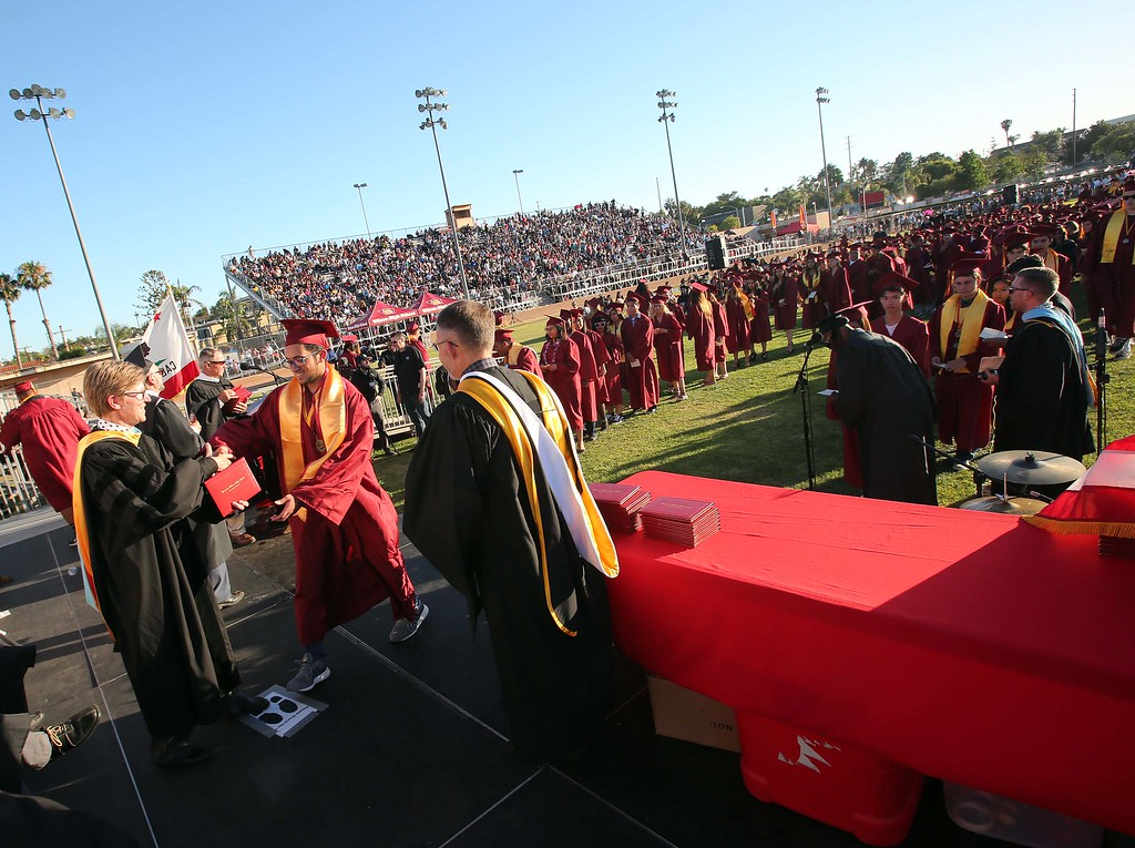 . June 15, 2017-Photo by Tracey Roman/for the Press-Telegram Students cross the stage and recieve their diplomas as the 2017 senior class of Wilson High School  graduate Thursday evening.