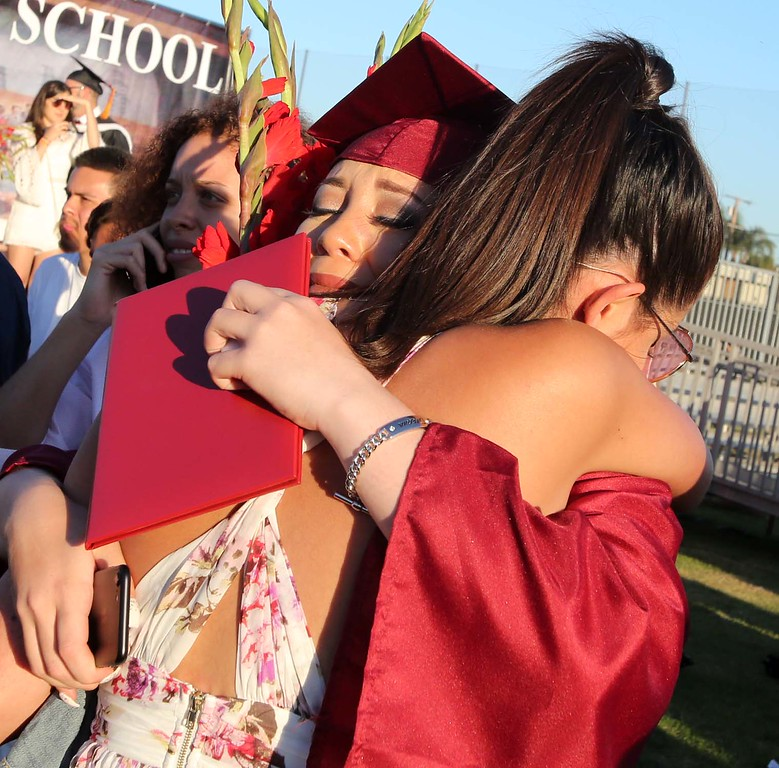 . June 15, 2017-Photo by Tracey Roman/for the Press-Telegram Best Friends Sydney Clay and Rozlin Dominguez embrace following Clay\'s Graduation ceremony from Wilson High School Thursday evening.