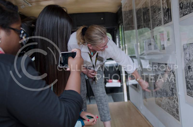 Kathrine Schlageck shows GraficoMovil in Manhattan, a mobile printmaking studio/gallery, created by Artemio Rodriguez, to Biak Sung, Dawt Lang, Shantanice Thomas, students of Kansas City Kansas Community College  (Saya Kakim  Collegian Media Group)