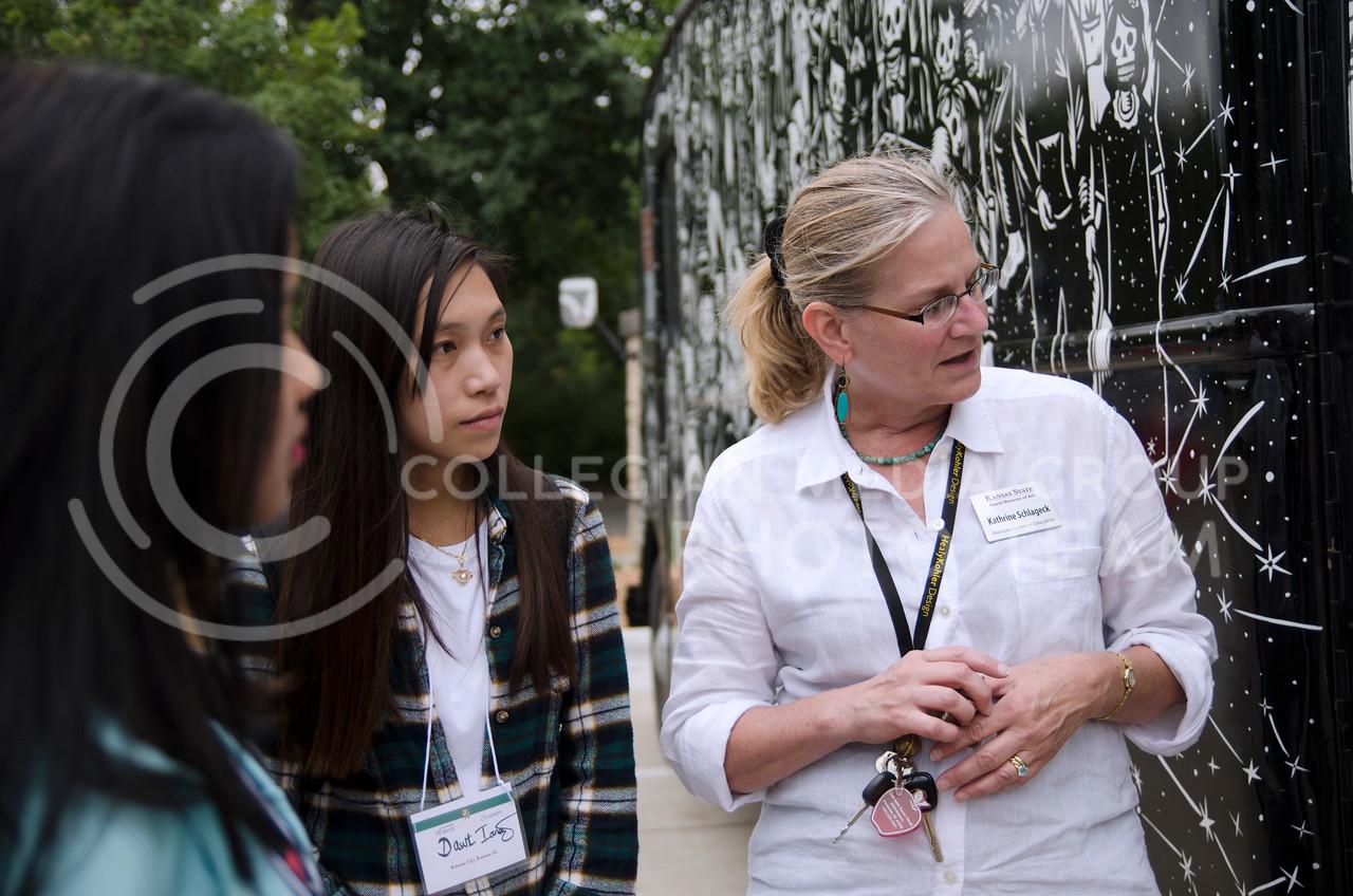 Kathrine Schlageck shows GraficoMovil in Manhattan, a mobile printmaking studio/gallery, created by Artemio Rodriguez, to Biak Sung, Dawt Lang, international students of Kansas City Kansas Community College  (Saya Kakim| Collegian Media Group)