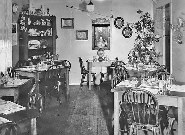 Tables set up at a the Four Corners Restaurant in Grafton. 'Approved by Duncan Hines July 14, 1950. Breakfast - Cantalope with Black Rasberrys, Country Ham, Eggs A La King, Toast, Jelly, Beverage.'