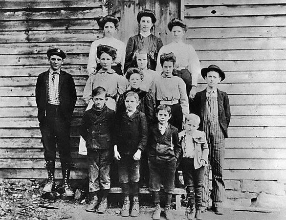 Class Photo Painter School, Taylor County, W. Va - 1908.<br /> 'First row, left to right: Walter Painter, Ray Bodkin, Lon Bodkin, Tommy Painter. Second row, left to right: Parion Cowger, Jessie Painter, Lynn Conrad, Lola Cowger, Myrtle Hevener, Oscar Painter. Third row, left to right: Ola Homan, Jessie Hammer (Teacher), Fanny Conrad.