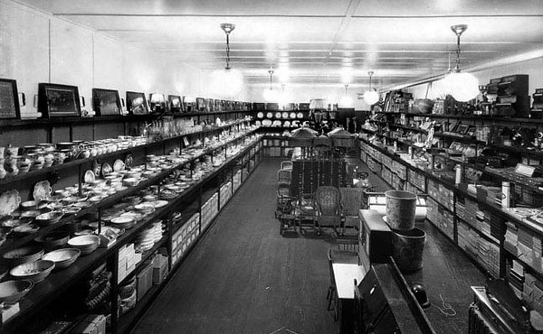 China, photographs, furniture, and other goods line the interior of C.G. Turner's Store in Grafton, WV 1924.