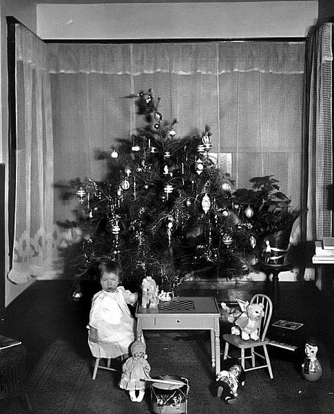 Child and Gifts in front of the Christmas Tree in Grafton, W. Va.